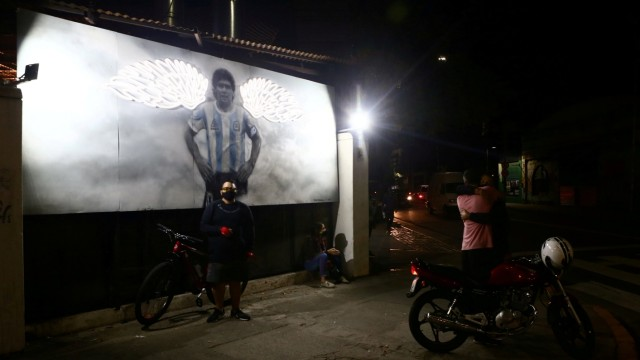Argentine artist immortalises soccer superstar Maradona with portraits, in Buenos Aires