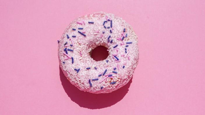 Studio shot of sweet doughnut with sugar sprinkles GEMF04005