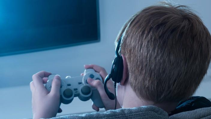 Boy Holding Joystick model released Symbolfoto PUBLICATIONxINxGERxSUIxAUTxONLY Copyright xAndreyPop