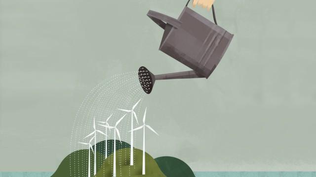 Geschäftsmann gießt Windturbinen PUBLICATIONxINxGERxSUIxAUTxONLY GregoryxBaldwin 12100040