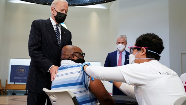 FILE PHOTO: U.S. President Joe Biden visits a vaccination site in Alexandria