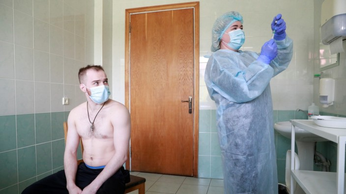 Members of the Ukrainian Olympic team receive COVID-19 vaccine in Kyiv
