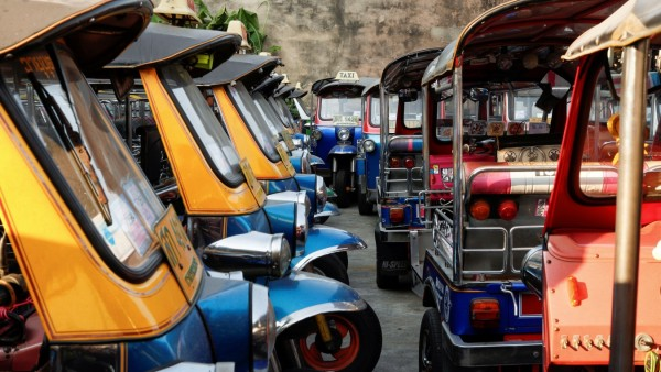 FILE PHOTO: Tuk-tuks that are used to transport tourists around the city are seen idle in a parking lot in downtown Bangkok