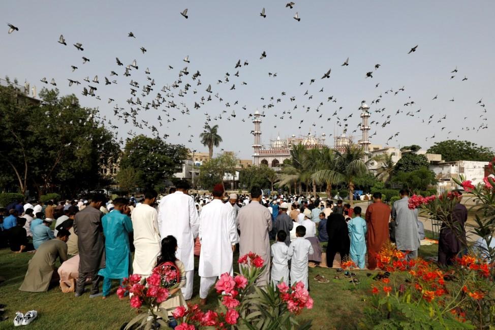Muslims celebrating Eid al-Fitr as the outbreak of the coronavirus disease (COVID-19) continues, in Karachi,