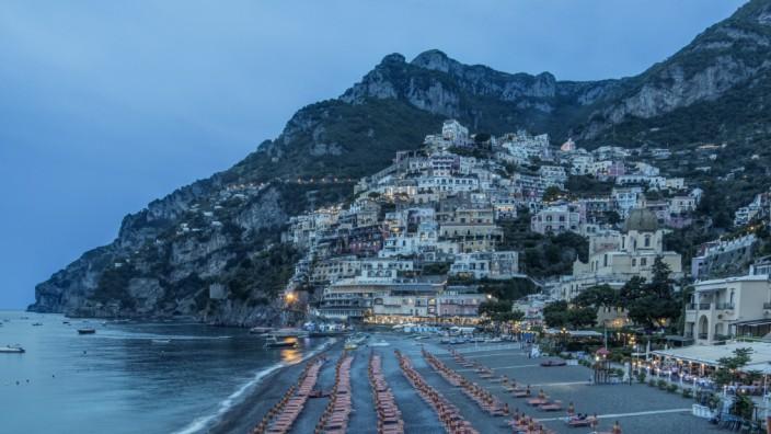 Europe, Italy, Amalfi Coast, Positano Beach at twilight (Rob Tilley / DanitaDelimont.com); Positano