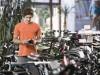 Young man buying bicycle Bavaria Germany mit_2003_01525