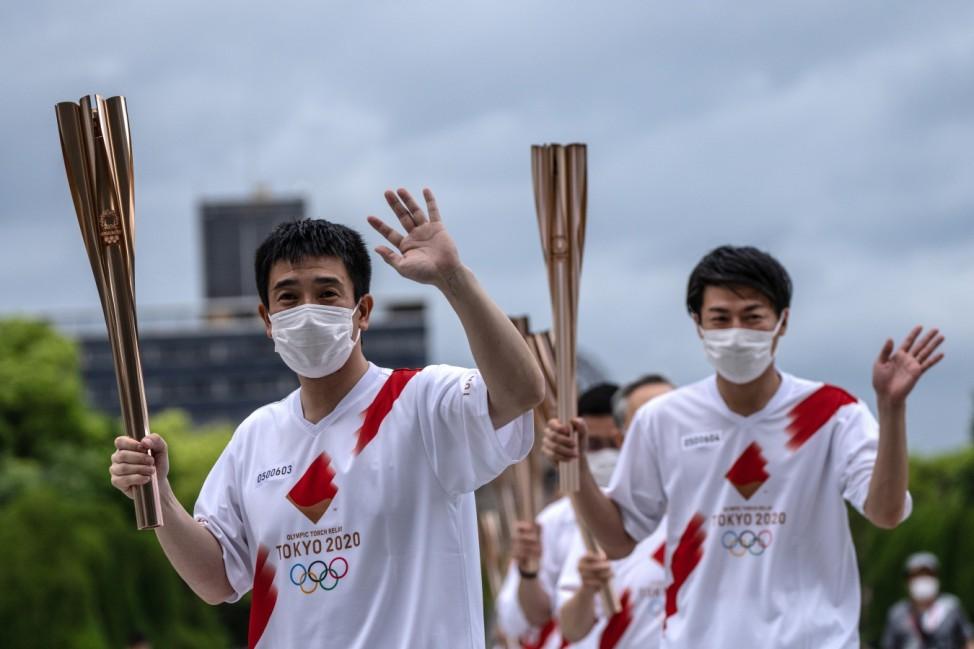 Olympischer Fackellauf in Hiroshima, Japan, für die Olympischen Spiele 2021 in Tokio.