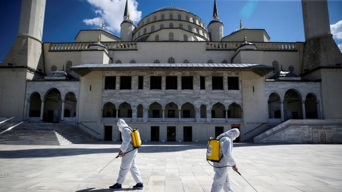 FILE PHOTO: Municipality workers disinfect courtyard of the Kocatepe Mosque in Ankara