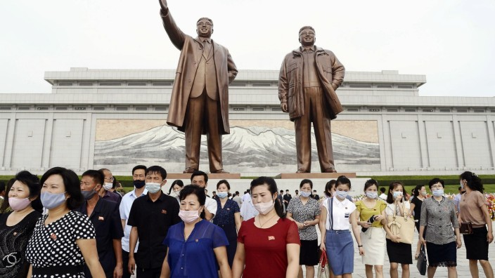 Scenes from Pyongyang North Korean citizens visit Mansu Hill in Pyongyang on July 8, 2020, wearing face masks amid conce