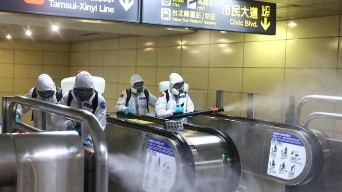 Soldiers disinfect Taipei main station following a surge of coronavirus disease (COVID-19) infections in Taipei