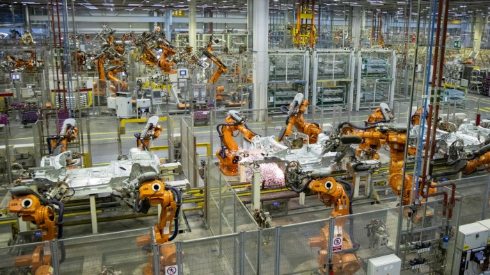Robots work on the MINI production line at the BMW group plant in Cowley, near Oxford on July 9, 2019. (Photo by Tolga Akmen / various sources / AFP)