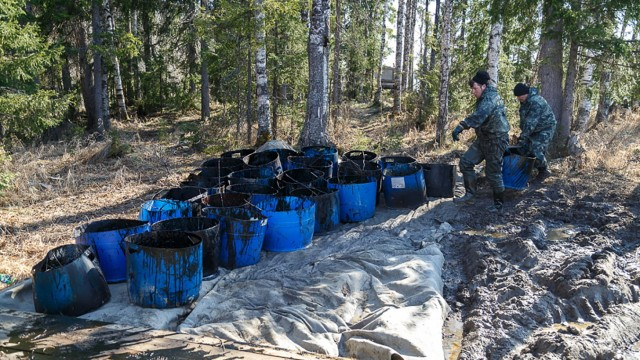 KOMI REPUBLIC, RUSSIA MAY 14, 2021: Cleaning up oil-containing fluid that got into the Kolva River in the town of Usin