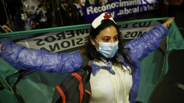 Argentine nurses march with torches to protest for their working conditions, in Buenos Aires