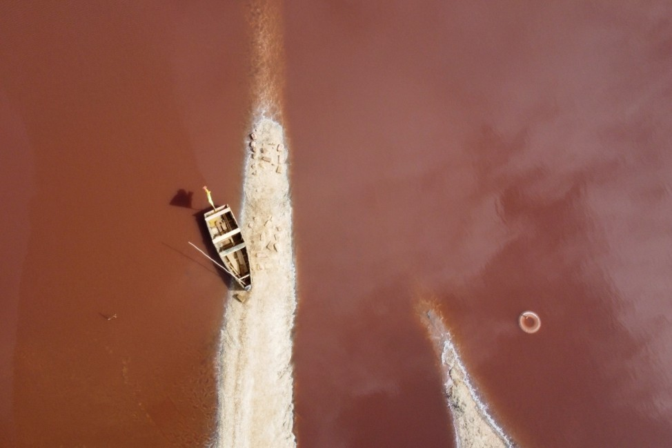 A view shows a boat at the edge of Lac Rose also known as Lake Retba in Niaga, near Dakar