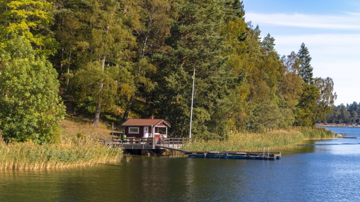 Wooden hut in traditional red at the Archipelago near Stockholm Sweden PUBLICATIONxINxGERxSUIxAUTxH