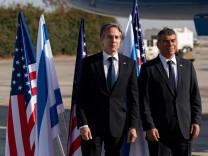 U.S. Secretary of State Antony Blinken talks with Israeli Foreign Minister Gabi Ashkenazi, upon arrival at Tel Aviv Ben Gurion Airport