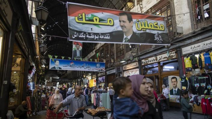 Der Hamadiyah-Markt in der Altstadt von Damaskus: Plakate zeigen Präsident Baschar al-Assad, das Wahlergebnis wird keine Überraschung sein.