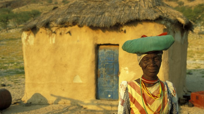 Namibia - Traditionally dressed Herero woman at her house in the vicinity of Warmquelle, a village in the southern Kaoko