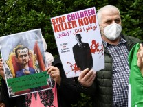 People protest against Assad re-election in Berlin