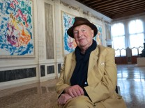 German artist Georg Baselitz poses inside the Portego hall on the main floor of the Museum of the Palazzo Grimani where