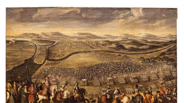 Geschichte: Am 16. August 1685 belagerten die Osmanen die Festung Gran (Esztergom). Eine kaiserliche Armee besiegte sie und zwang sie zum Abzug. Das kurz danach angefertigte Gemälde zeigt den Moment, als der Angriff der Osmanen zusammenbricht.