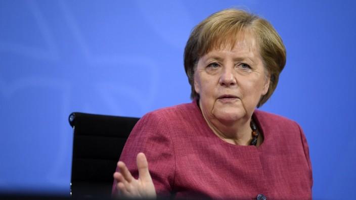 German Chancellor Merkel and Minister President of Brandenburg Woidke address the media in Berlin