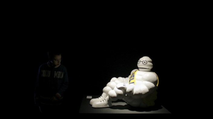 File photo of young visitor looking at 'Bibendum' sculpture, Michelin company's mascot in Madrid