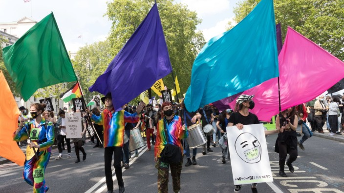 May 29, 2021, London, United Kingdom: LGBTQ representatives dressed up with rainbow-coloured fabric wave flags during t