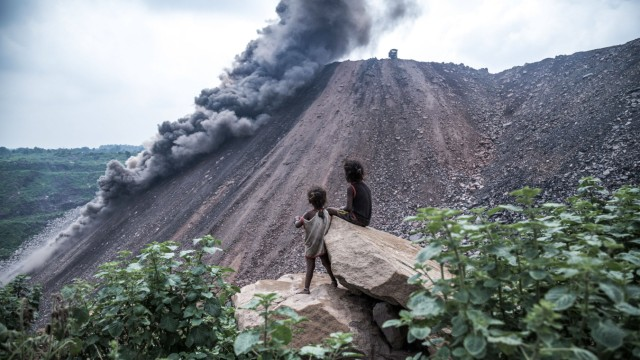 August 22, 2019 Jharia, Jharkhand, India: Two children are witnessing dumping in a dumping ground near a coal mine. Earl