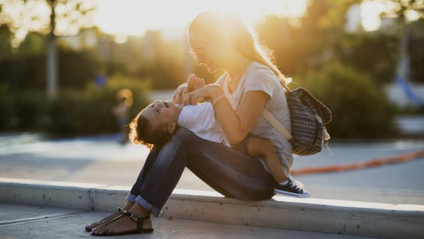 Happy mother playing with her little son on a square at sunset model released Symbolfoto PUBLICATION
