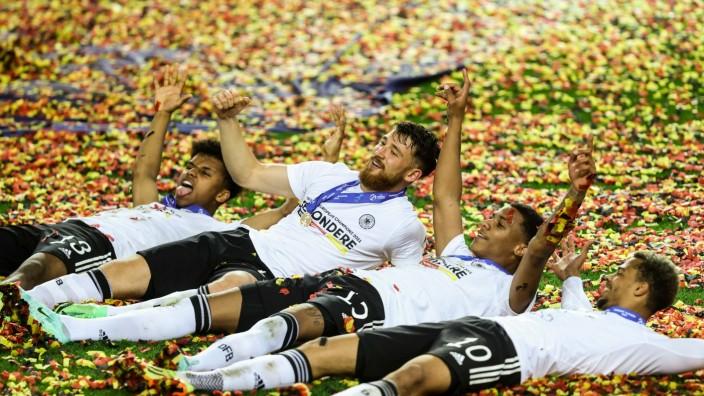 LJUBLJANA, SLOVENIA - JUNE 06: Karim Adeyemi, Salih Ozcan, Ismail Jakobs and Lukas Nmecha of Germany celebrate following
