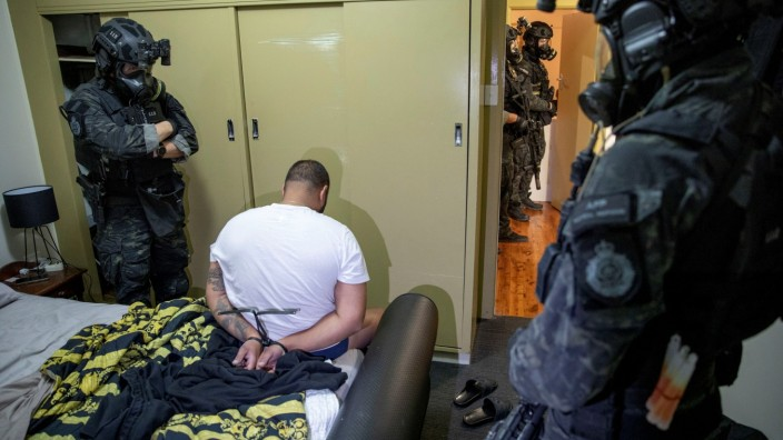 Person is detained by Australian Federal Police after its Operation Ironside against organised crime
