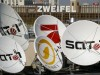 File picture shows satellite dishes of the German television stations Kabel 1 SAT 1 and Pro Sieben on the roof of the company's office in Berlin