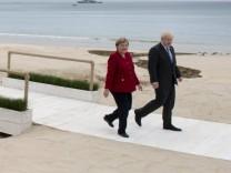 June 11, 2021, Carbis Bay, United Kingdom: United Kingdom Prime Minister Boris Johnson and German Chancellor Angela Mer