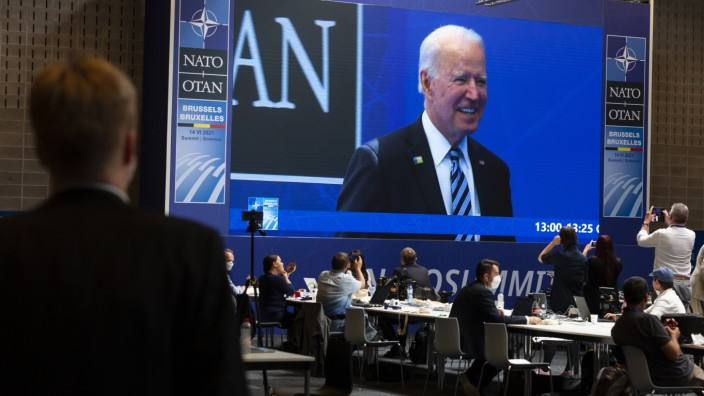 Mr. Joe Biden, President of the United States. View of the press room of the NATO summit. On the giant screen, the image