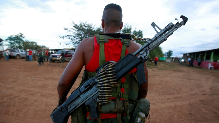 FILE PHOTO: A fighter of the Revolutionary Armed Forces of Colombia (FARC) arrives at a camp, near El Diamante in Yari Plains