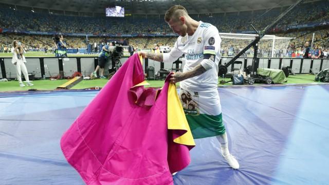 Sergio Ramos of Real Madrid act like a bullfighter torero during the UEFA Champions League final be; Sergio Ramos