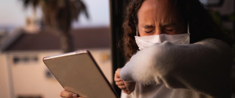 Woman wearing a face mask at home. Social distancing in quarantine during coronavirus epidemic Cauca