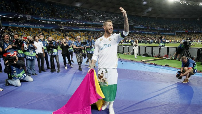 Sergio Ramos of Real Madrid puts on a Matador routine during the UEFA Champions League Final match a