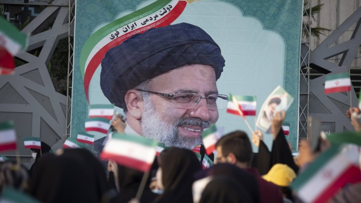 Iran Goes to the Polls in Presidential Election Supporters of the Iranian president elect Ebrahim Raisi wave Iran flags