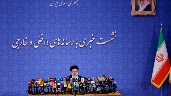 Iran's President-elect Ebrahim Raisi speaks during a news conference in Tehran