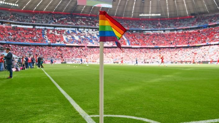 Allianz Arena Stadium with rainbow colored corner flag agains discrimination football stadium trib