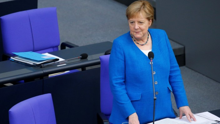 German Chancellor Angela Merkel attends the last session of the lower house of parliament Bundestag before federal elections, in Berlin