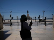 A person takes a picture in Lisbon downtown amid the coronavirus disease (COVID-19) pandemic, in Lisbon