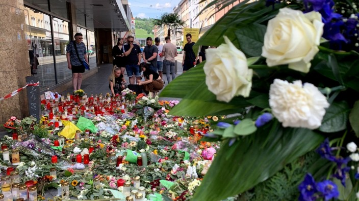 People lay flowers in German town of Wuerzburg after stabbing