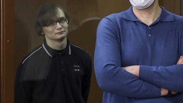 MOSCOW, RUSSIA - JANUARY 18, 2021: Defendant Azat Miftakhov (L), a postgraduate at Lomonosov Moscow State University, at