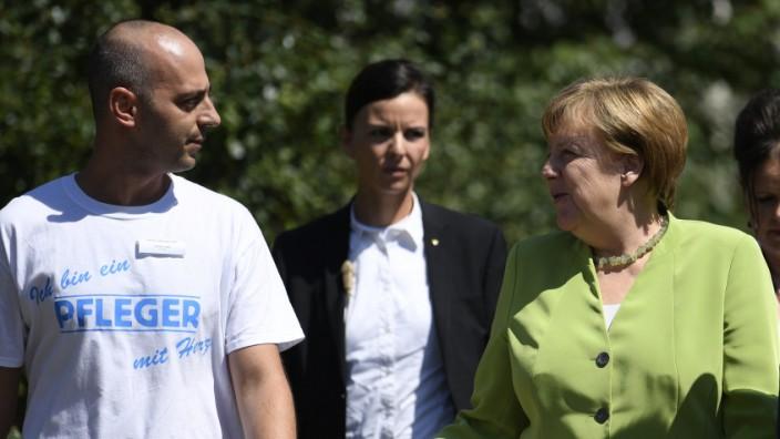 Pfleger Ferdi Cebi, Bundeskanzlerin Angela Merkel
