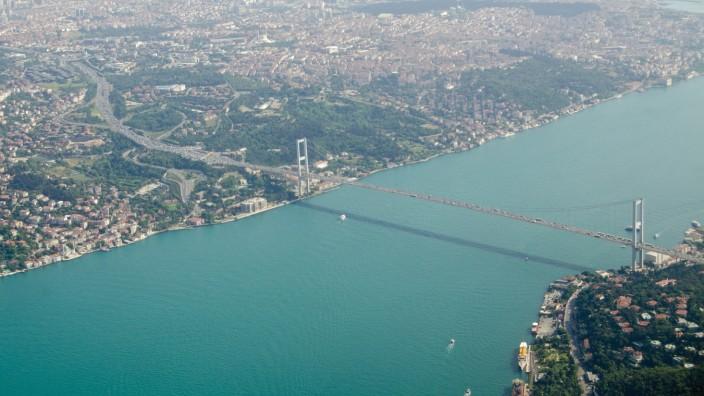 Aerial view of the First Bosphorus Bridge spanning the Bosphorus in Istanbul, Turkey. The suspension bridge, known in Turkish as Boaziçi Köprüsü, links Ortaköy in Europe and Beylerbeyi in Asia. (BasPhoto)