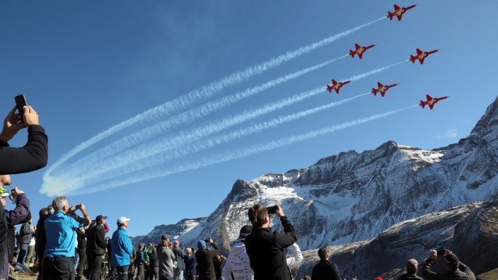 Members of the Patrouille Suisse perform in their Swiss Air Force Northrop F-5E Tiger II fighter jets over the Axalp