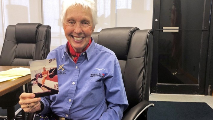 FILE PHOTO: Wally Funk, a Virgin Galactic ticketholder and one of the First Lady Astronaut Trainees or âĘMercury 13âÄÖ women, is pictured holding a photo of herself at the International WomenâÄÖs Air and Space Museum in Cleveland